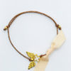 gold wings cross bracelet brown