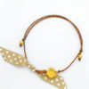 gold cross brown polka dots bracelet