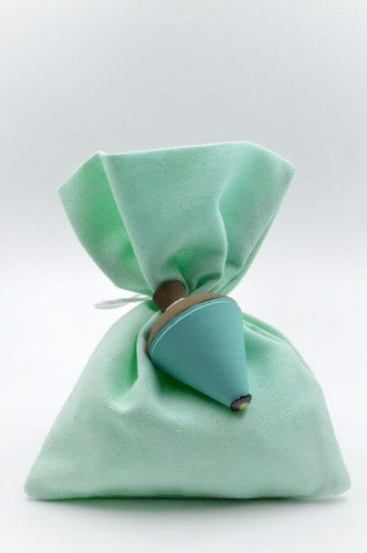 green spinning top green pouch