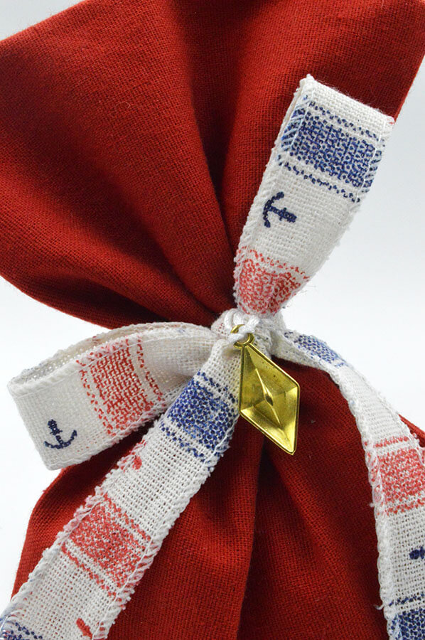 red pouch gold ship navy favor bow